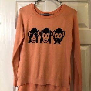 Pink monkey emoji sweater